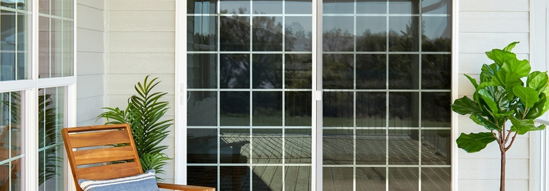 encompass by pella sliding patio door with two single-hung windows on each side