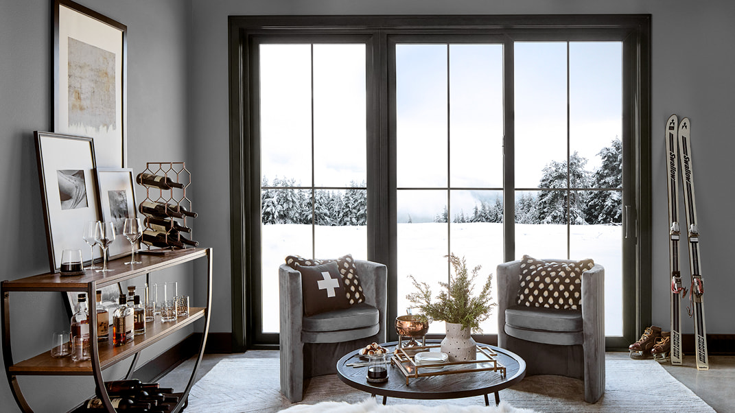 living room with winter background impervia sliding patio door