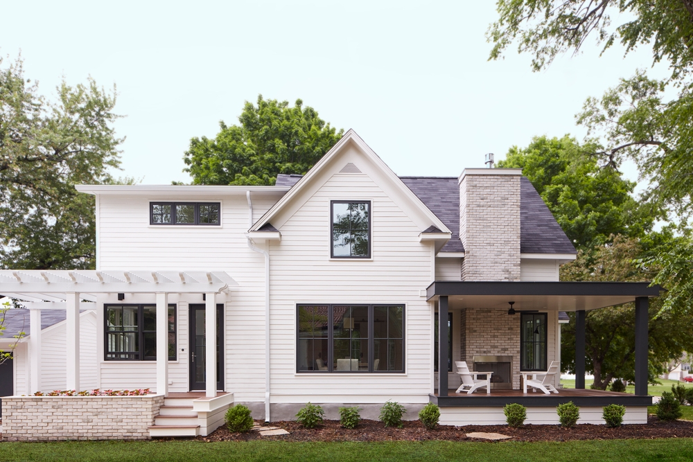 modern farmhouse with black windows and doors