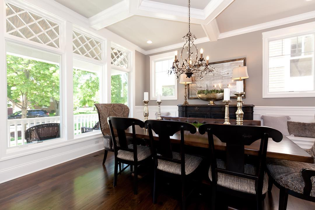white casement windows and dark wood furniture in traditional dining room