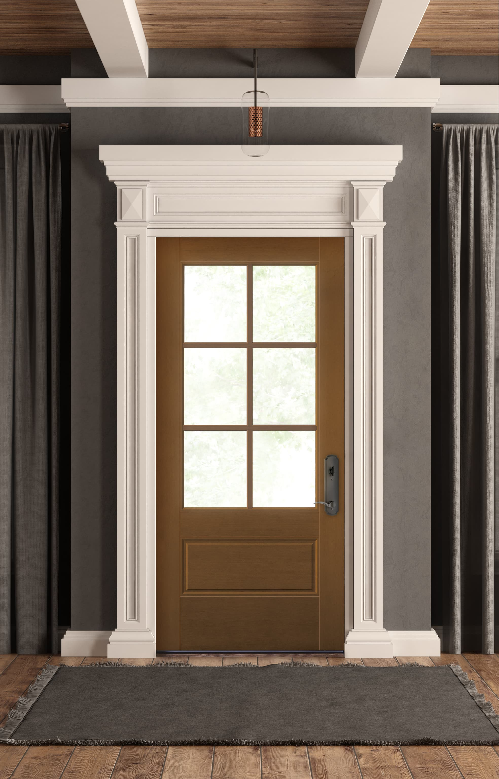 Brown front door with white decorative trim contrasts gray walls in entry