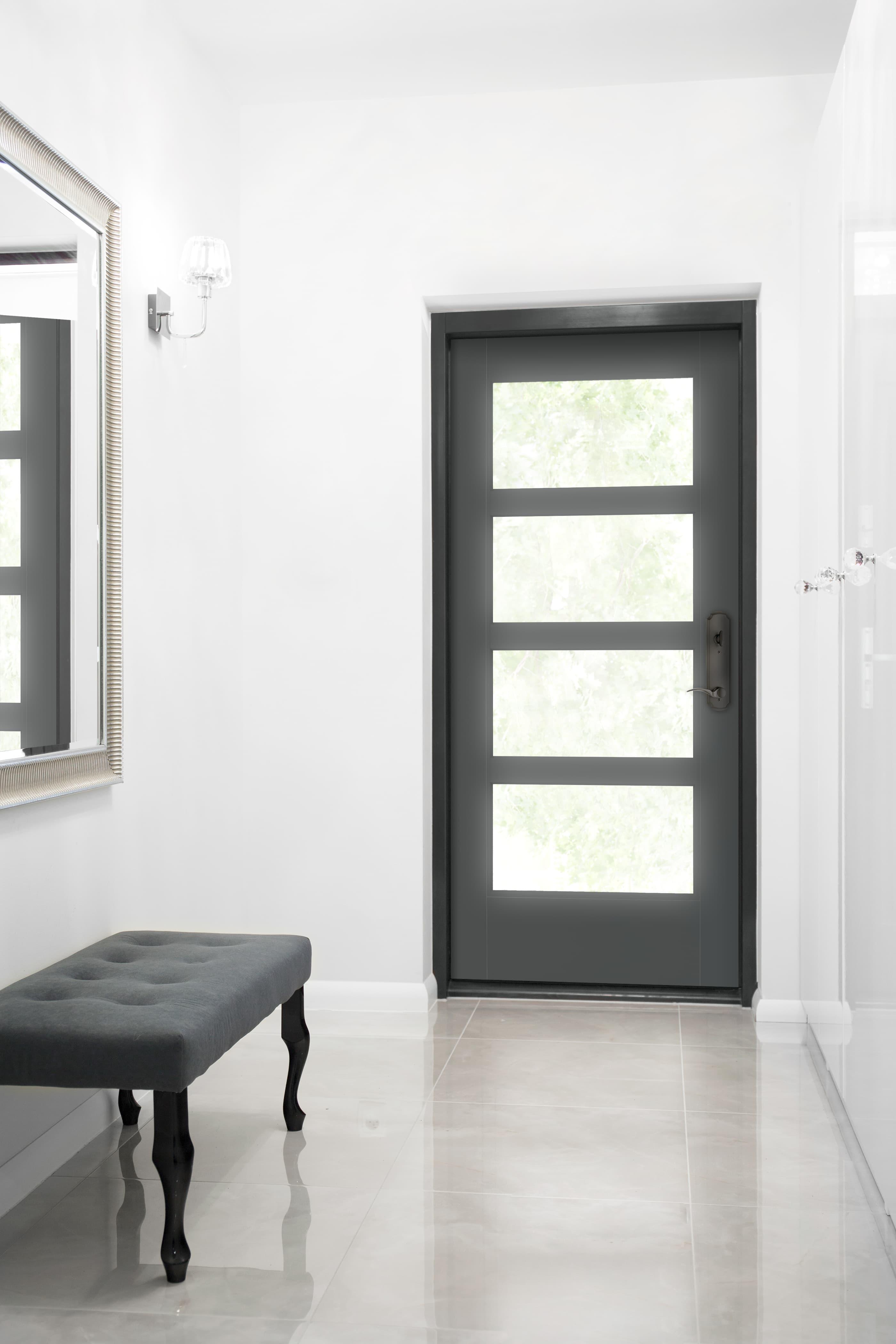 Black front door with glass panels contrasts modern white entryway