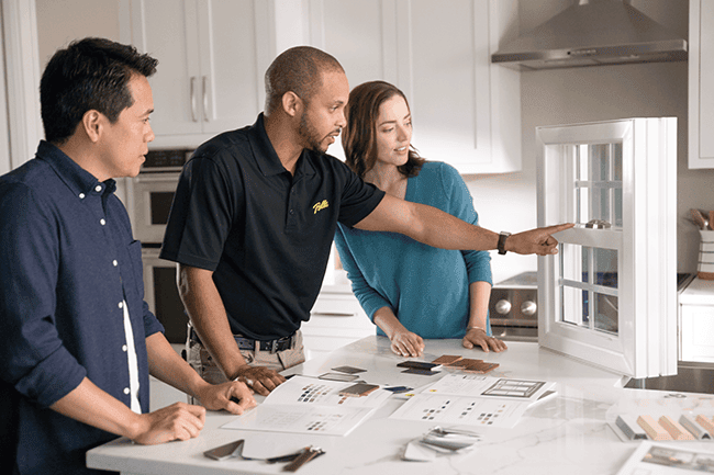 three people looking at window features and options