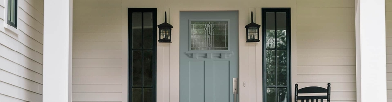 frost blue entry door with dark transoms on each side