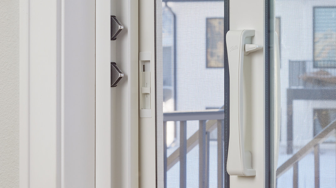 impervia sliding patio door with a white lock