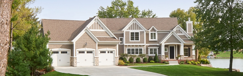 large traditional home with lifestyle series windows