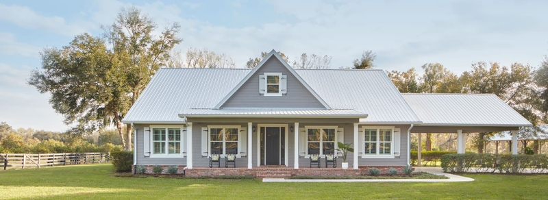 gray home exterior with impact-resistant windows