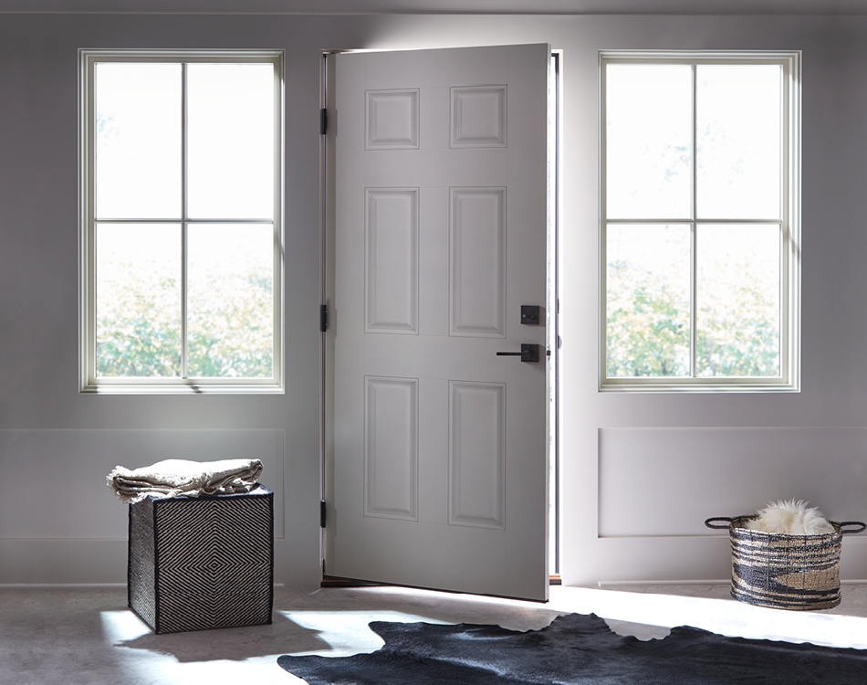 Contemporary white door open a crack with two white windows on either side