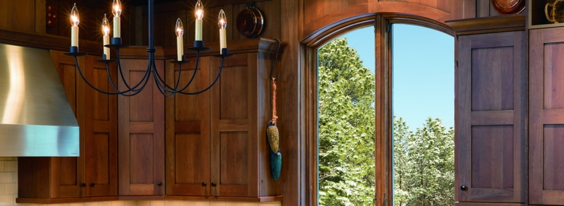 arched push-out casement windows in wood kitchen