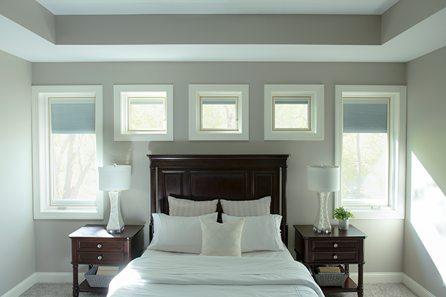 bedroom with lifestyle series casement windows surrounding the headboard
