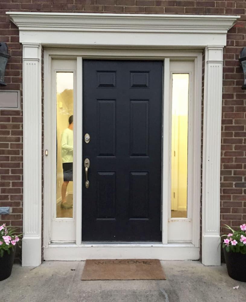 Black front entry door before