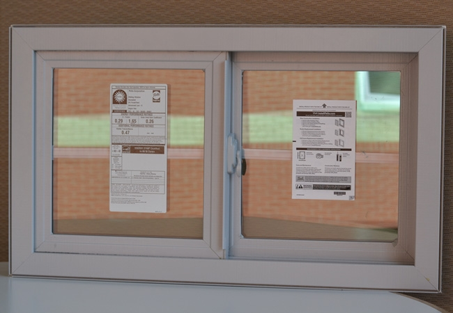 A white sliding window with labels containing window information on each panel.