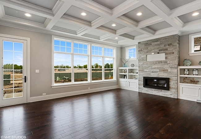 Living Room with crown molding and dark wood floors.