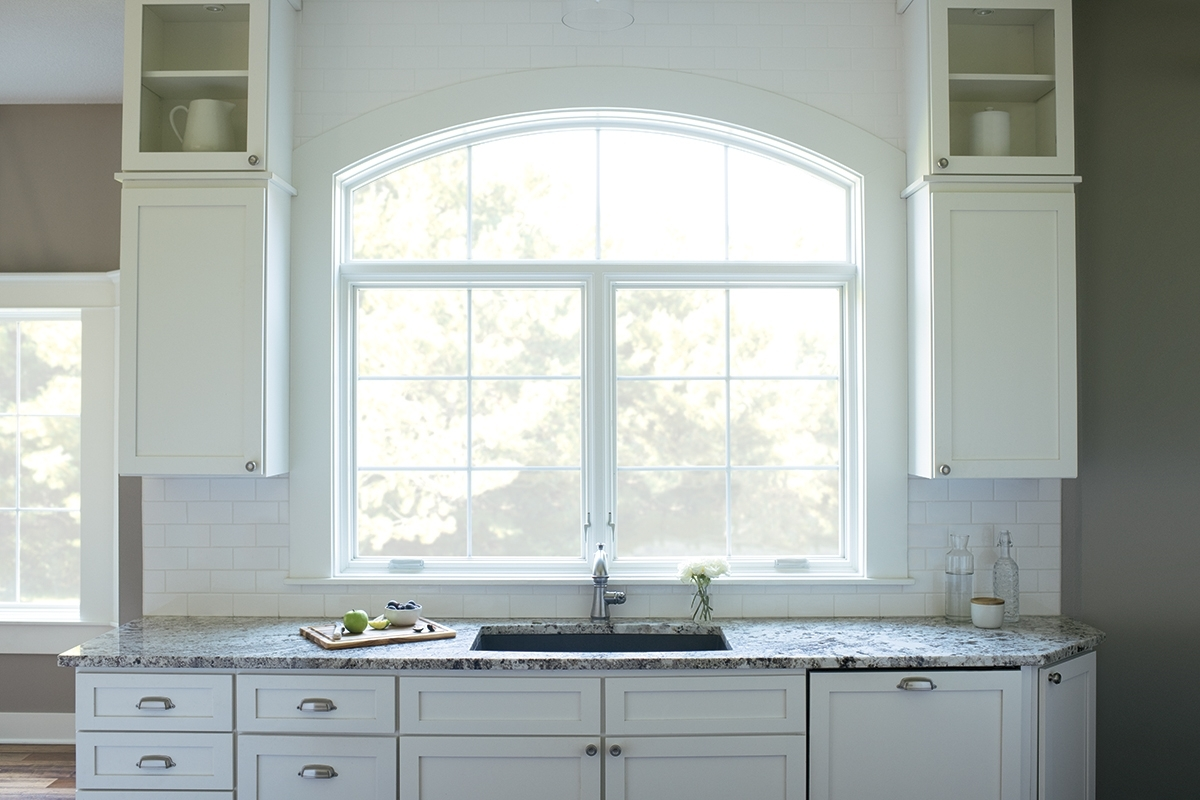 White toned kitchen with Lifestyle series window.
