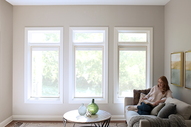 woman sitting by energy efficient lifestyle series windows