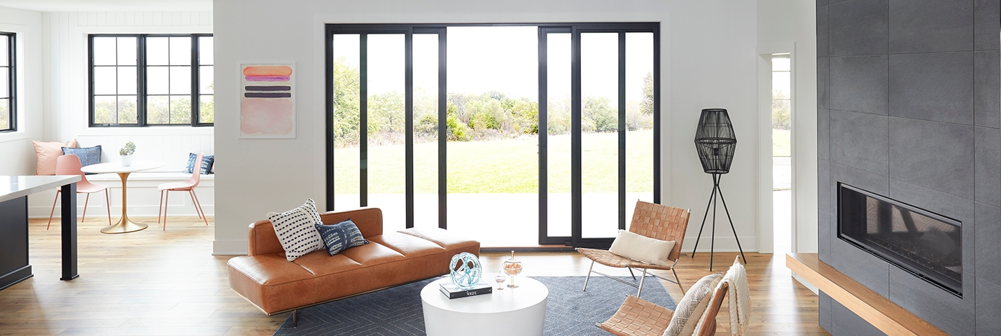 contemporary living room with four panel sliding patio doors