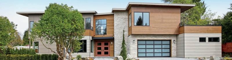 contemporary home with exterior trim on a fiberglass entry door