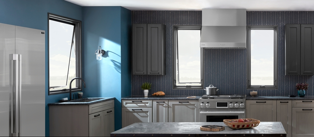 Tall awning windows light dark blue and gray kitchen