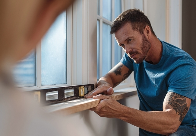 Man making home improvements.