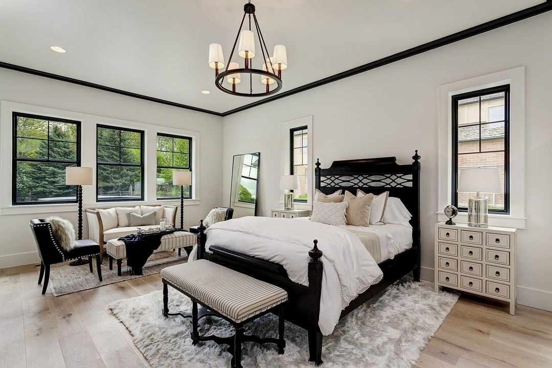 black and white bedroom with black frame windows
