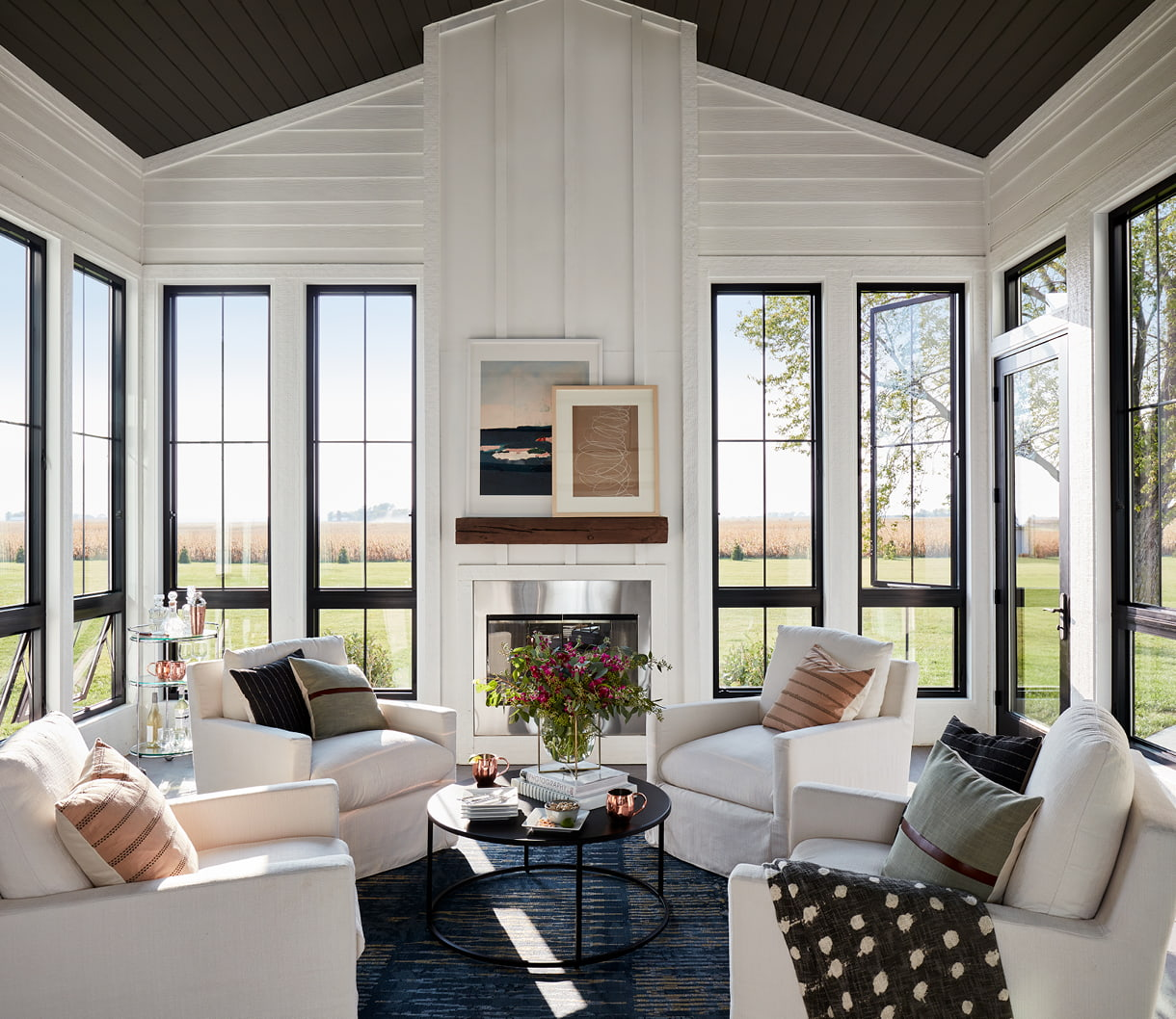 contemporary living room with black casement windows