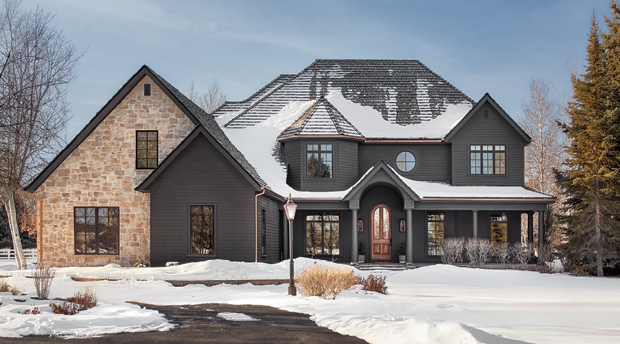 Two Story Gray Home with brown door on Chris Loves Julia
