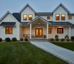 exterior of a home at dusk with impervia double-hung windows
