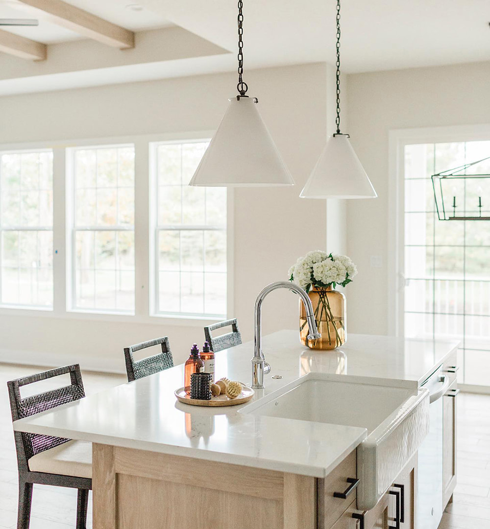 White double-hung windows and patio door in traditional kitchen.