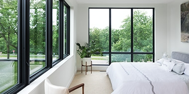 windows by pella two walls of black-trimmed windows
