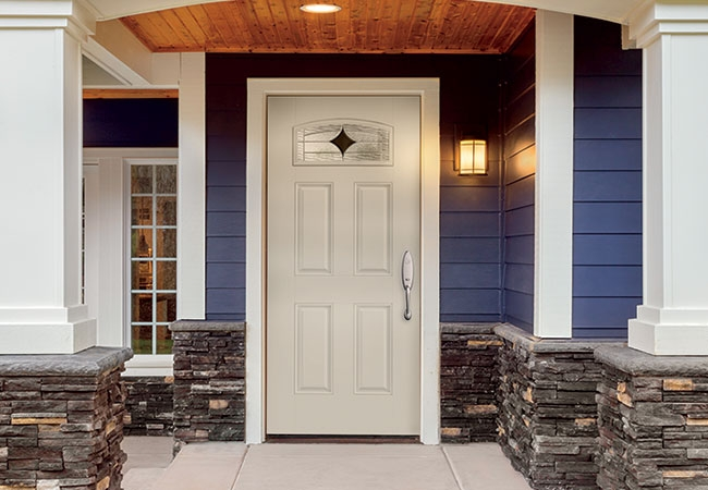 White entry door on blue house.