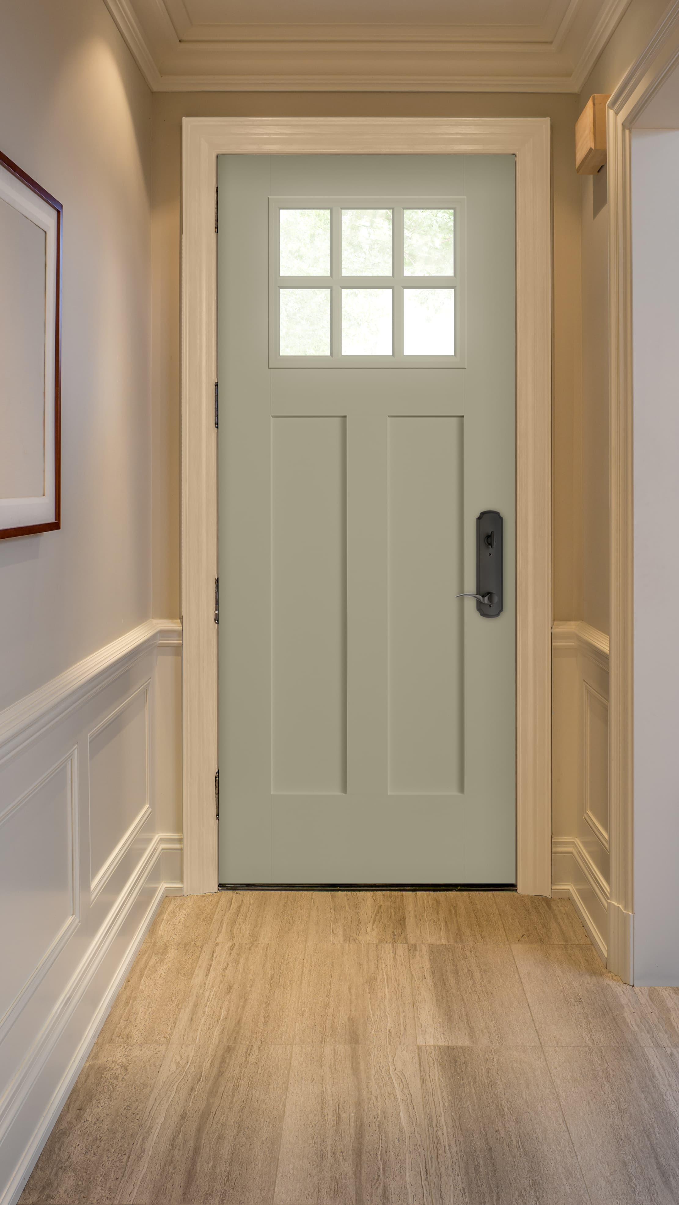 Blue craftsman front door lights up neutral color entryway