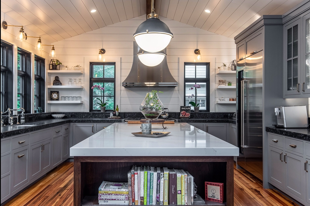 black windows, white walls, and dark gray cabinets create contrast in rustic style kitchen