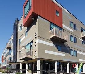 Corner view of The Rose multifamily housing development.