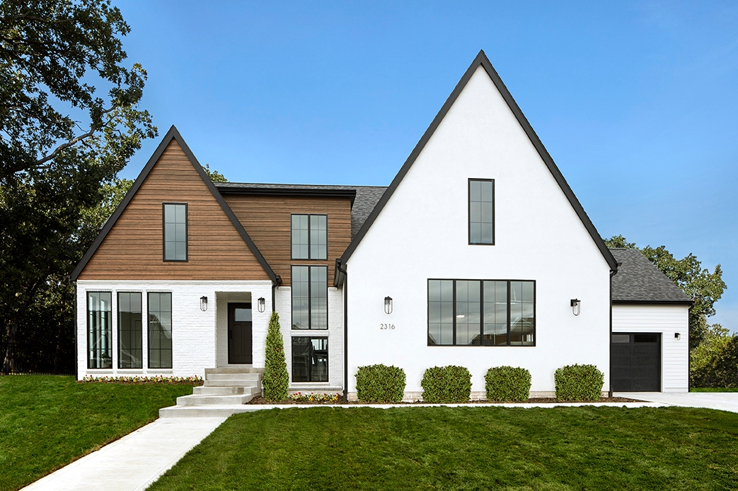 Digital two-story home with white and exposed wood exterior with black framed windows with grilles