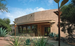 exterior of a southwestern building with wood installation