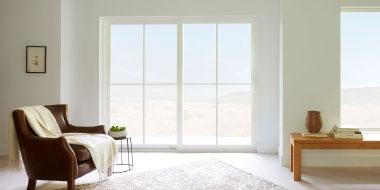 interior of living room with white vinyl sliding patio door