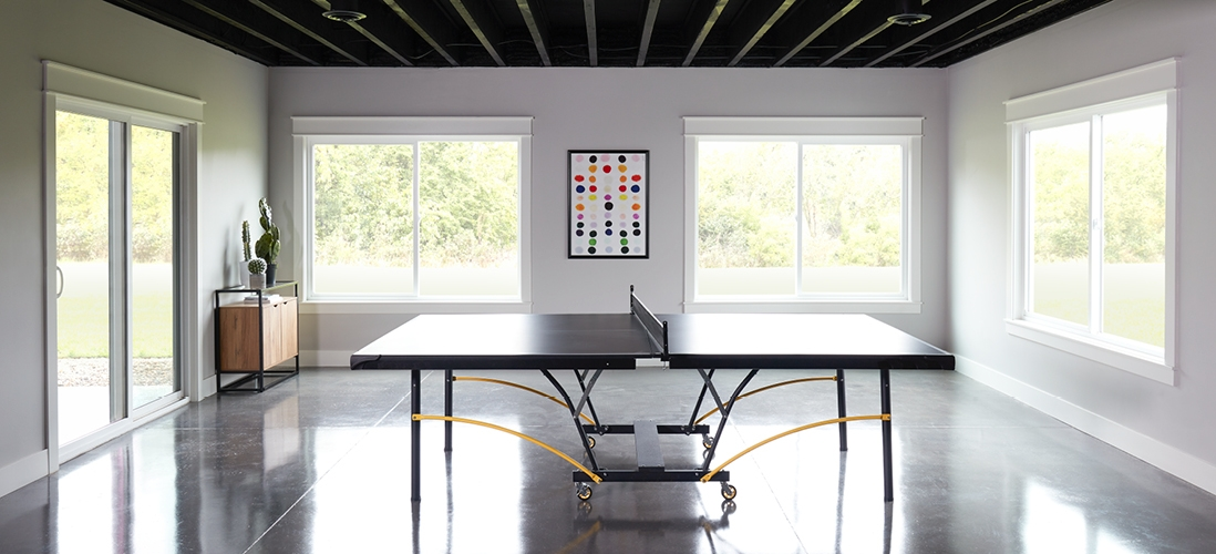 250 series sliding windows in a family rec room ping pong table