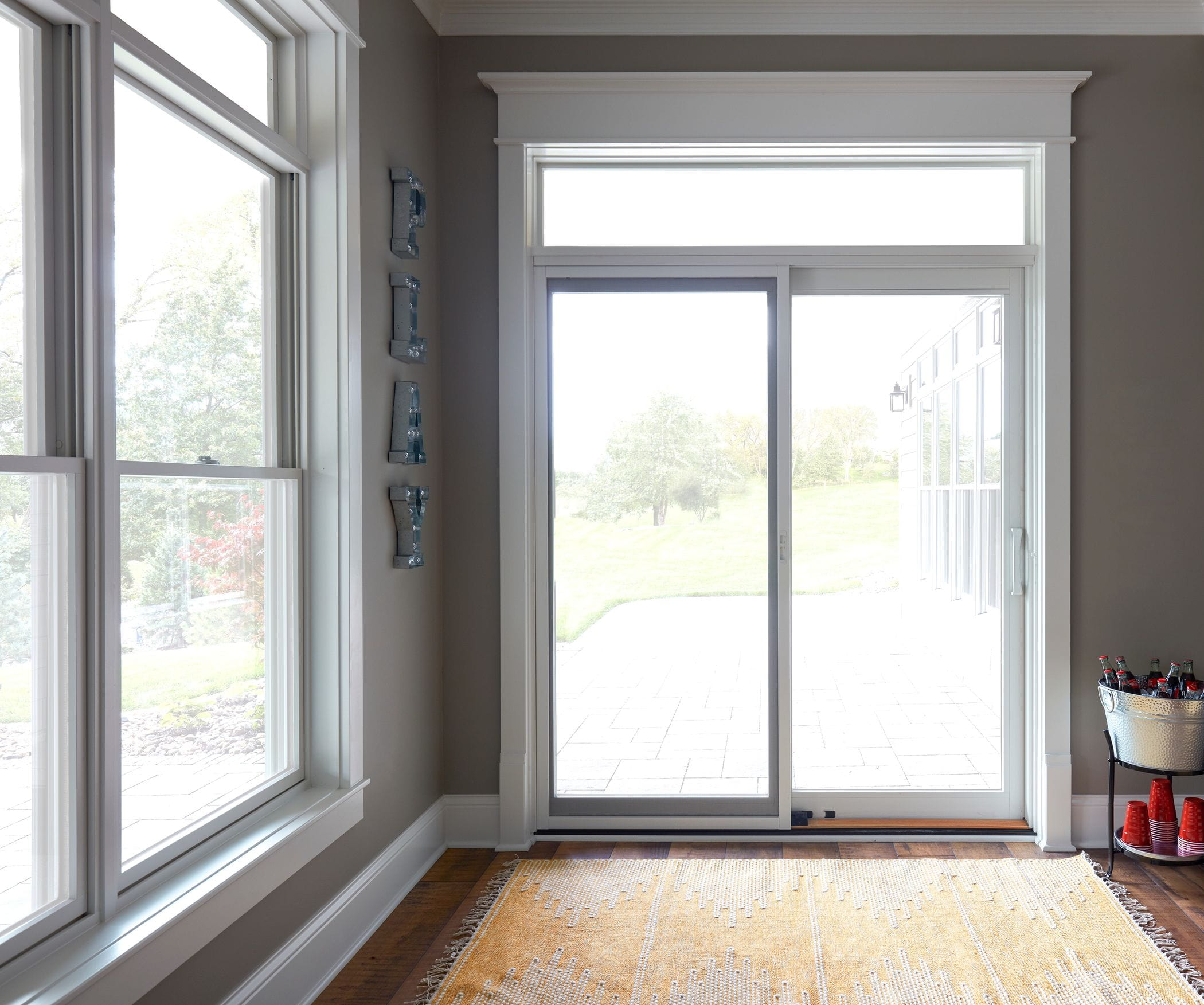 A white sliding glass patio door in a sunroom