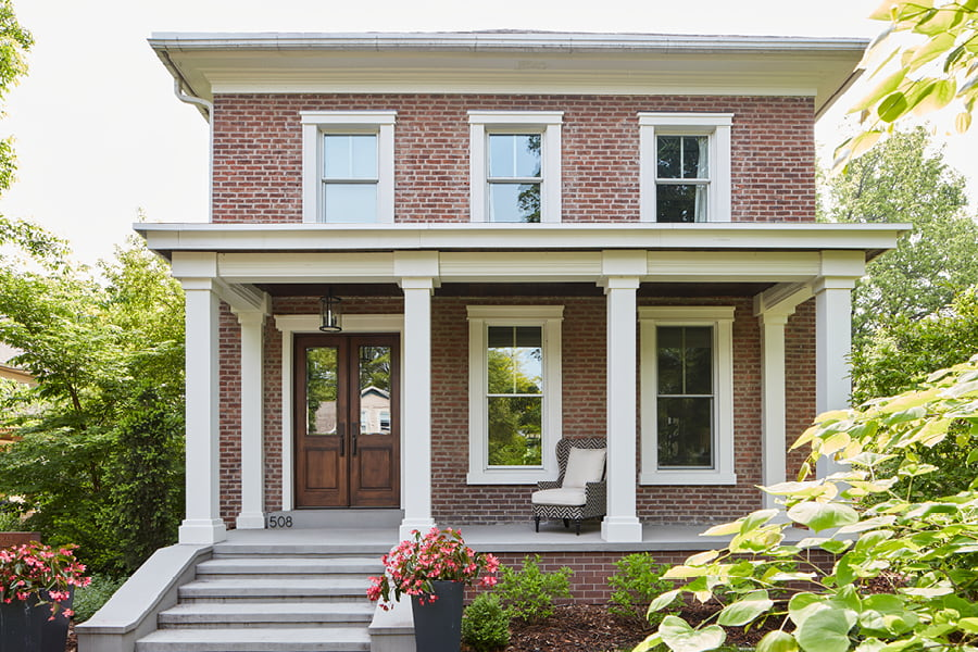 Two Story Traditional Colonial with Wood Entry Door, white trimming and patio