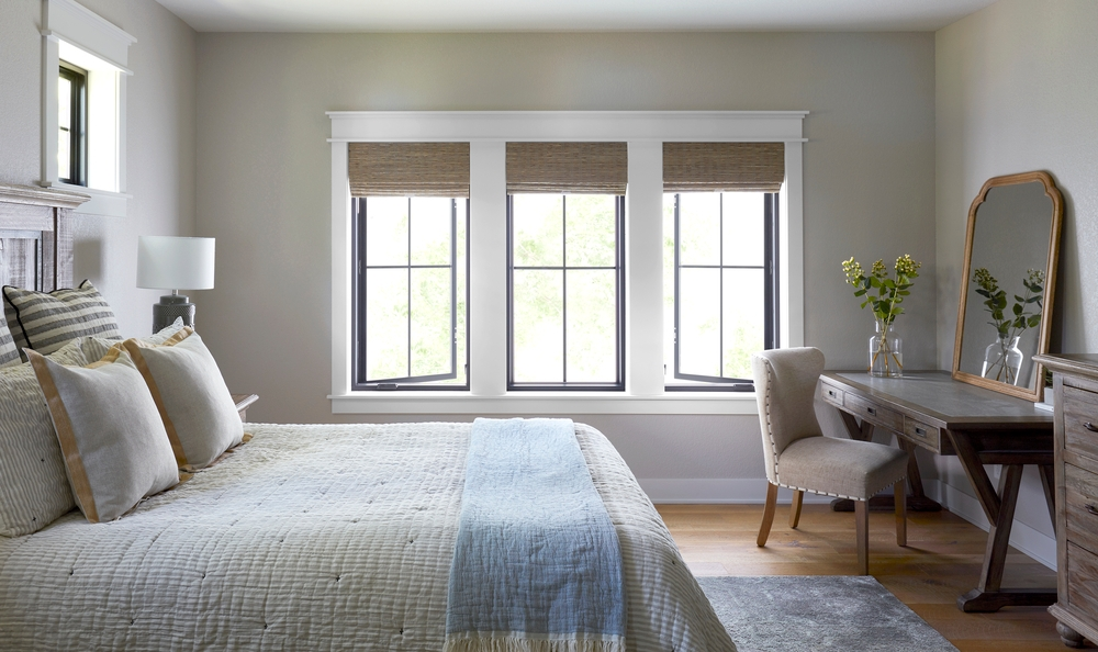 black casement windows with white trim in bedroom