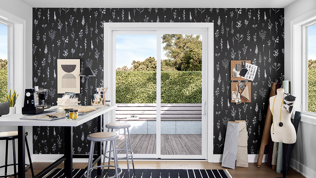 impervia sliding patio door in a sewing room with black wallpaper