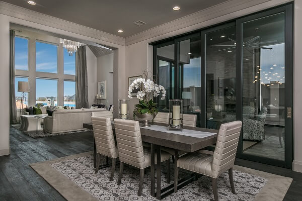 Elegant dining room has large multi-slide patio door connecting to the patio