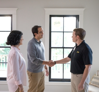 man shaking the hand of a pella salesperson