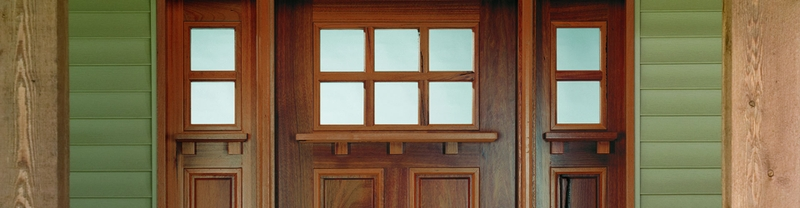wood entry door with 2x4 grilles and 1/4 light sidelights