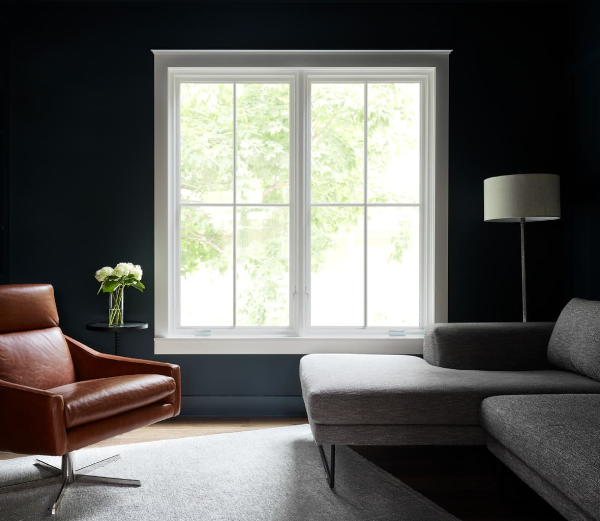two white casement windows on a black wall