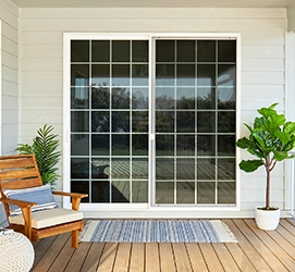 encompass sliding patio door on a back deck with traditional grilles